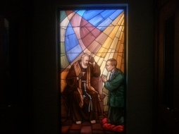Stained glass Padre hearing confession