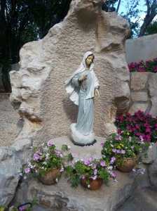 Our Lady's statue with Cross