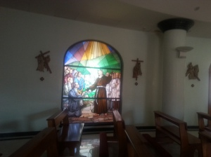 Beautiful stained glass of Padre Pio in hotel chapel