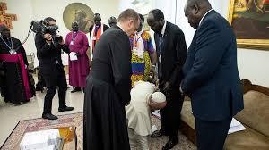 Pope kissing Feet of Sudan leaders